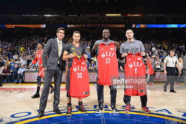 Klay Thompson Draymond Green and Stephen Curry of the Golden State Warriors are presented with their All Star jerseys on February 9 2016 at Oracle...