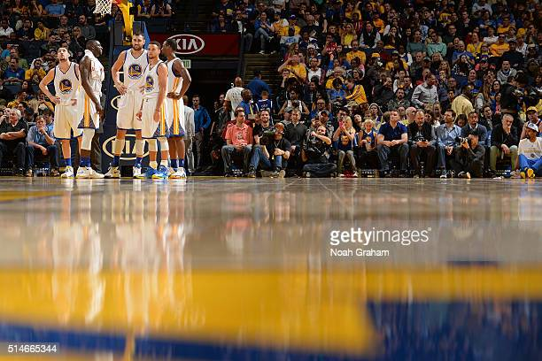 Klay Thompson Draymond Green Andrew Bogut Stephen Curry and Harrison Barnes of the Golden State Warriors stand on the court during the game against...