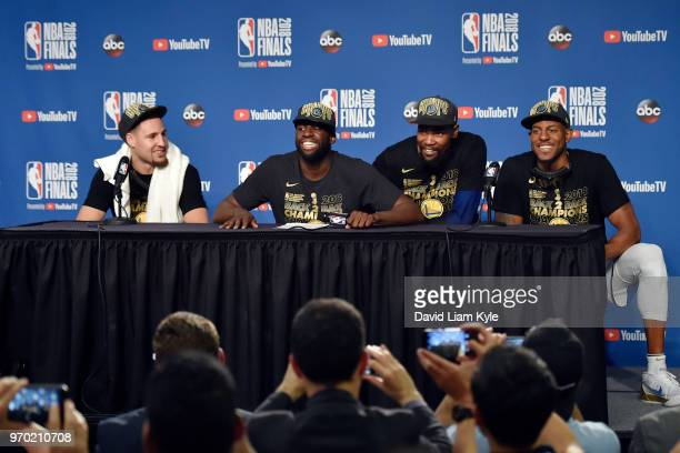 OH Klay Thompson Draymond Green Finals MVP Kevin Durant and Andre Iguodala of the Golden State Warriors speaks to the media after defeating the...