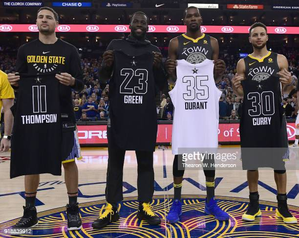 Klay Thompson Draymond Green Kevin Durant and Stephen Curry of the Golden State Warriors display their Allstar jerseys prior to the start of an NBA...