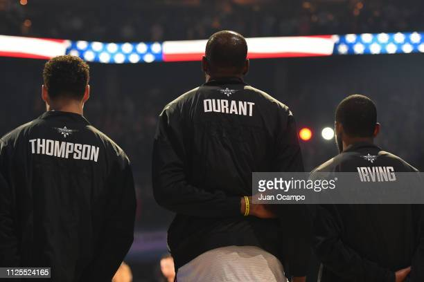 Klay Thompson Kevin Durant and Kyrie Irving of Team LeBron stand on the court for the National Anthem before the 2019 NBA AllStar Game on February 17...