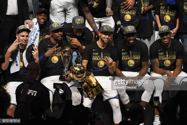Klay Thompson Kevin Durant Stephen Curry Draymond Green and Andre Iguodala pose for a photo after defeating the Cleveland Cavaliers during Game Four...