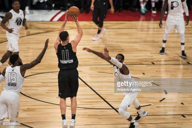 Klay Thompson of Team Stephen shoots a threepointer under pressure during the 2018 NBA AllStar Game at the Staples Center in Los Angeles California...
