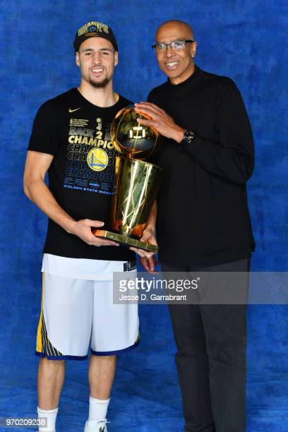 Klay Thompson of the Golden State Warriors and his father Mychal Thompson pose for a portrait with the Larry O'Brien Championship trophy after...