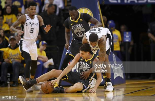 Klay Thompson of the Golden State Warriors and LaMarcus Aldridge of the San Antonio Spurs go for a loose ball during Game 2 of Round 1 of the 2018...