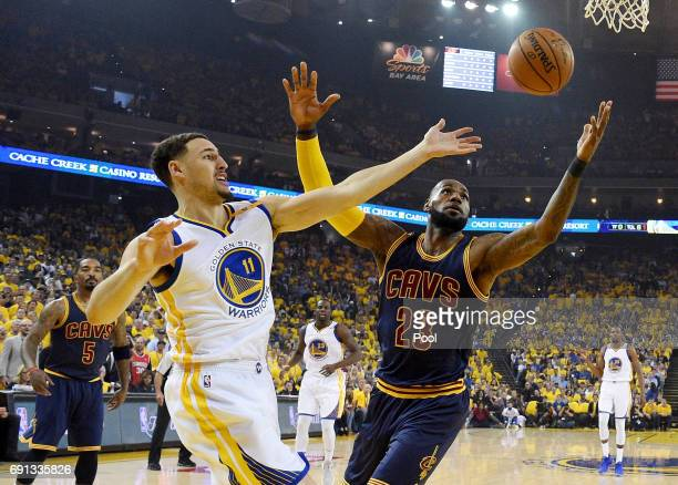 Klay Thompson of the Golden State Warriors and LeBron James of the Cleveland Cavaliers look to posses a loose ball in Game 1 of the 2017 NBA Finals...