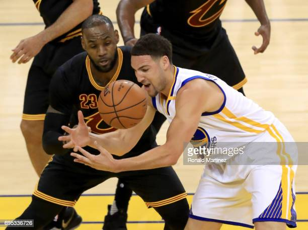 Klay Thompson of the Golden State Warriors and LeBron James of the Cleveland Cavaliers go for a loose ball in Game 5 of the 2017 NBA Finals against...