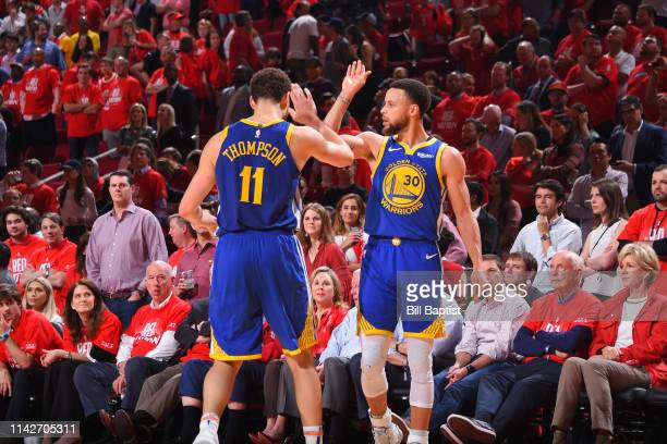 Klay Thompson of the Golden State Warriors and Stephen Curry of the Golden State Warriors react during a game against the Houston Rockets during Game...