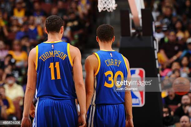 Klay Thompson of the Golden State Warriors and Stephen Curry of the Golden State Warriors looks on during a preseason game against the Los Angeles...