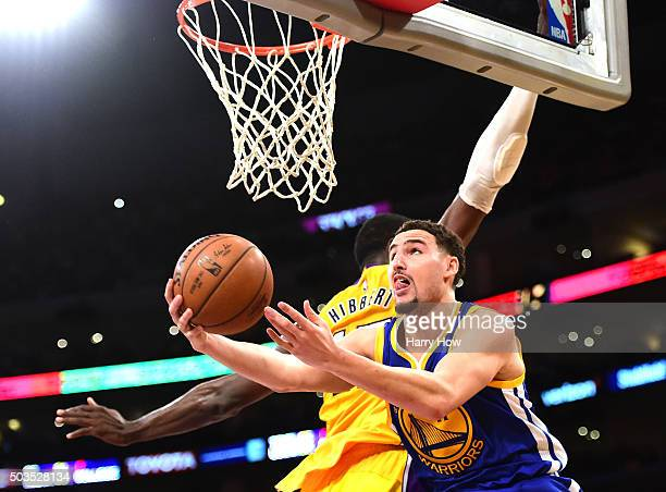 Klay Thompson of the Golden State Warriors attempts a layup around Roy Hibbert of the Los Angeles Lakers during the first half at Staples Center on...