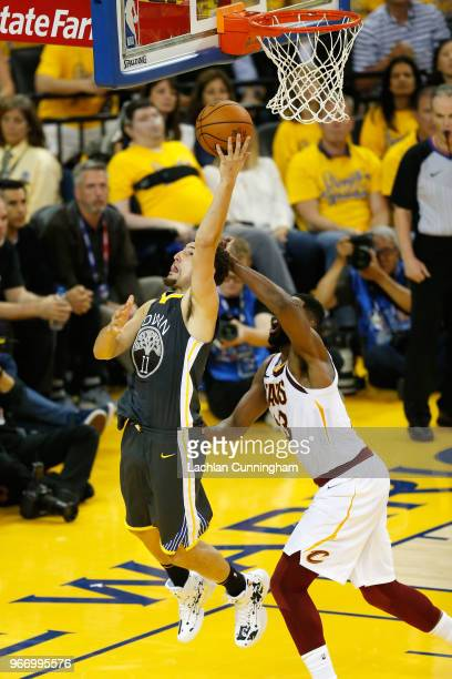 Klay Thompson of the Golden State Warriors attempts a layup over Tristan Thompson of the Cleveland Cavaliers during the third quarter in Game 2 of...