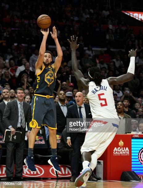 Klay Thompson of the Golden State Warriors attempts a three point shot against Montrezl Harrell of the Los Angeles Clippers on November 12 2018 at...
