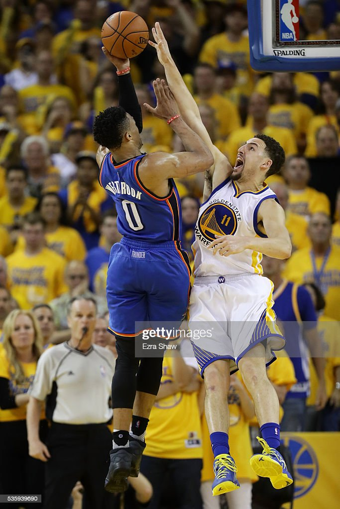 Klay Thompson #11 of the Golden State Warriors blocks a shot by Russell Westbrook #0 of the Oklahoma City Thunder in Game Seven of the Western Conference Finals during the 2016 NBA Playoffs at ORACLE Arena on May 30, 2016 in Oakland, California.