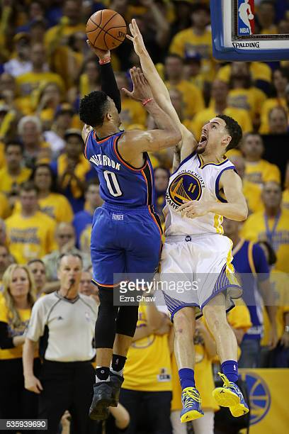 Klay Thompson of the Golden State Warriors blocks a shot by Russell Westbrook of the Oklahoma City Thunder in Game Seven of the Western Conference...