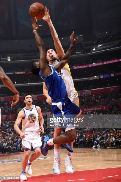 Klay Thompson of the Golden State Warriors blocks the shot of Jawun Evans of the LA Clippers on January 6 2018 at STAPLES Center in Los Angeles...