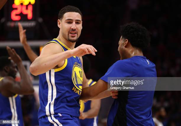 Klay Thompson of the Golden State Warriors celebrates a second half three point basket while playing the Detroit Pistons at Little Caesars Arena on...