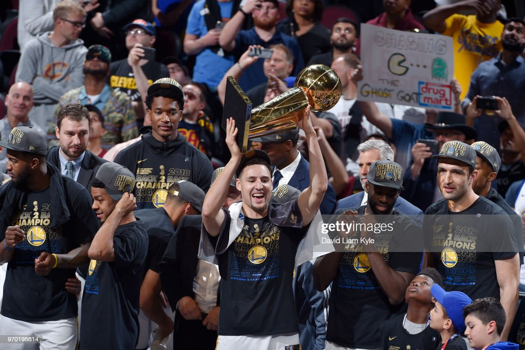 OH - Klay Thompson #11 of the Golden State Warriors celebrates after the game against the Cleveland Cavaliers while holding the Larry O'Brien NBA Championship Trophy after Game Four of the 2018 NBA Finals on June 8, 2018 at Quicken Loans Arena in Cleveland, Ohio.
