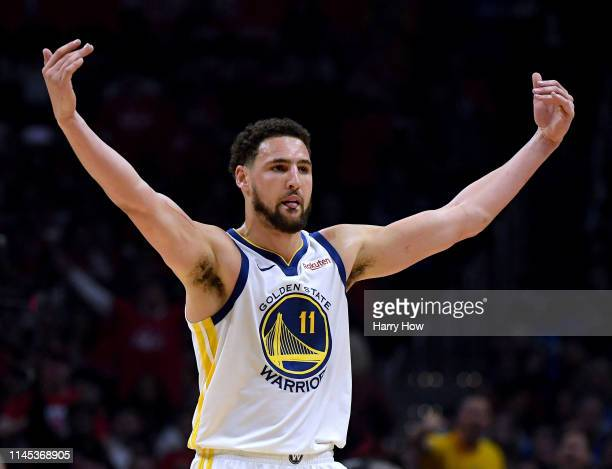 Klay Thompson of the Golden State Warriors celebrates an offensive foul by Montrezl Harrell of the LA Clippers in the first half during Game Six of...