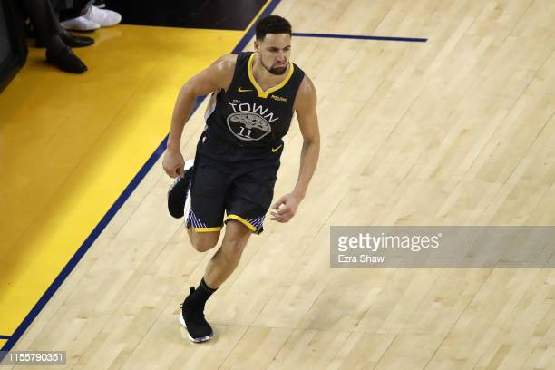 Klay Thompson of the Golden State Warriors celebrates the basket against the Toronto Raptors in the first half during Game Six of the 2019 NBA Finals...