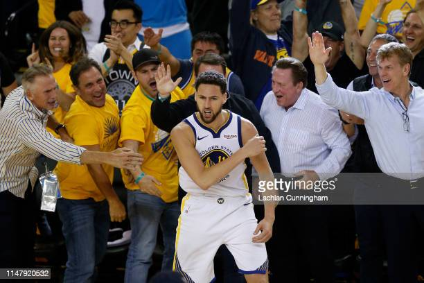 Klay Thompson of the Golden State Warriors celebrates with fans during Game Five of the Western Conference Semifinals of the 2019 NBA Playoffs...