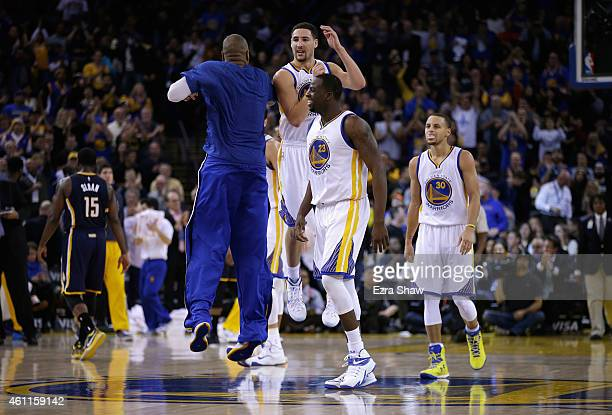 Klay Thompson of the Golden State Warriors celebrates with Marreese Speights, Draymond Green, and Stephen Curry of the Golden State Warriors after he...