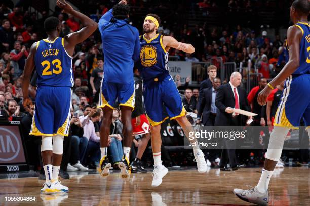 Klay Thompson of the Golden State Warriors celebrates with teammates after hitting his 14th three pointer to break the single game record for the...