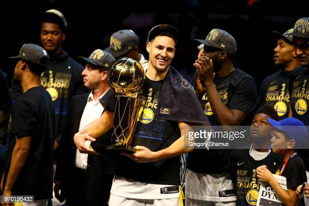 Klay Thompson of the Golden State Warriors celebrates with the Larry O'Brien Championship Trophy after winning the 2018 NBA Finals 10885 against the...