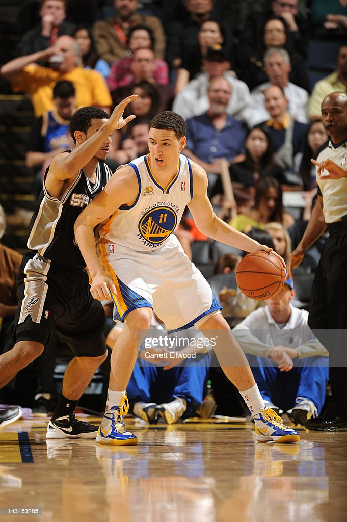 Klay Thompson #11 of the Golden State Warriors controls the ball against Cory Joseph #5 of the San Antonio Spurs on April 26, 2012 at Oracle Arena in Oakland, California.