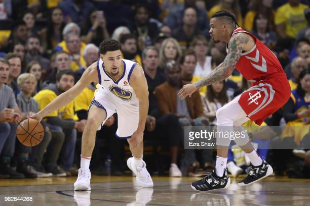 Klay Thompson of the Golden State Warriors controls the ball against Gerald Green of the Houston Rockets during Game Six of the Western Conference...