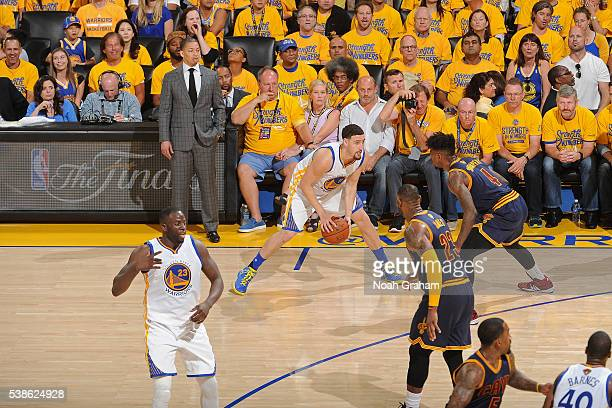 Klay Thompson of the Golden State Warriors dribbles the ball while defended by Iman Shumpert of the Cleveland Cavaliers during Game Two of the 2016...