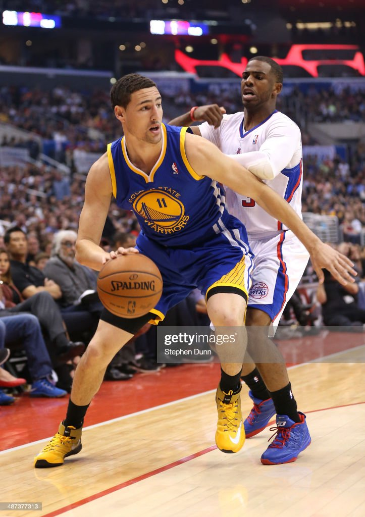 Klay Thompson #11 of the Golden State Warriors drives against Chris Paul #3 of the Los Angeles Clippers in Game Five of the Western Conference Quarterfinals during the 2014 NBA Playoffs at Staples Center on April 29, 2014 in Los Angeles, California.