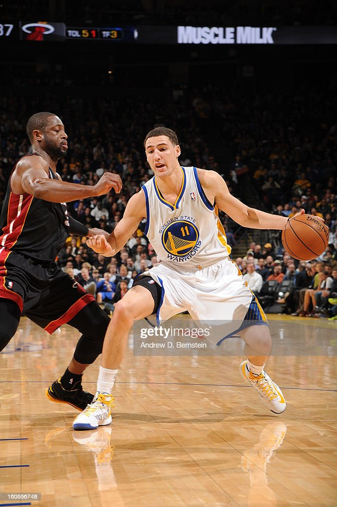 Klay Thompson #11 of the Golden State Warriors drives against Dwyane Wade #3 of the Miami Heat on January 16, 2013 at Oracle Arena in Oakland, California.