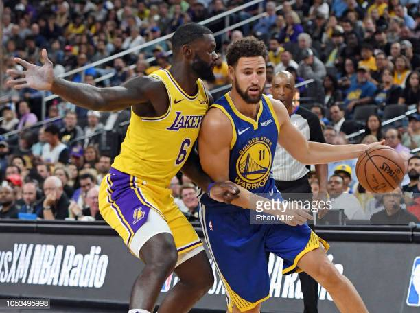 Klay Thompson of the Golden State Warriors drives against Lance Stephenson of the Los Angeles Lakers during their preseason game at TMobile Arena on...