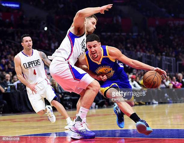 Klay Thompson of the Golden State Warriors drives on Blake Griffin of the LA Clippers during the first half at Staples Center on December 7 2016 in...