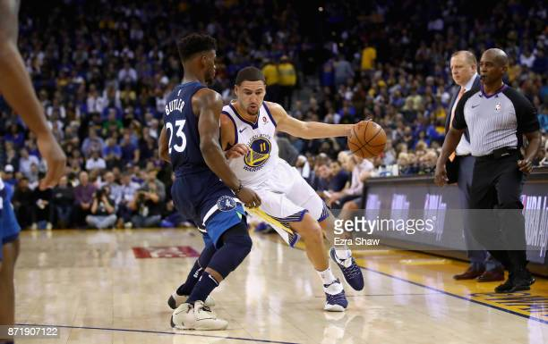 Klay Thompson of the Golden State Warriors drives on Jimmy Butler of the Minnesota Timberwolves at ORACLE Arena on November 8 2017 in Oakland...