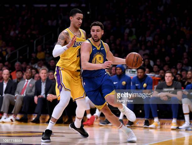 Klay Thompson of the Golden State Warriors drives on Kyle Kuzma of the Los Angeles Lakers during a 130111 Warriors win at Staples Center on January...