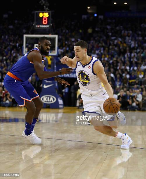 Klay Thompson of the Golden State Warriors drives on Tim Hardaway Jr #3 of the New York Knicks at ORACLE Arena on January 23 2018 in Oakland...