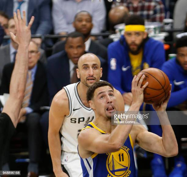 Klay Thompson of the Golden State Warriors drives past Manu Ginobili of the San Antonio Spurs at ATT Center on April 19 2018 in San Antonio Texas...