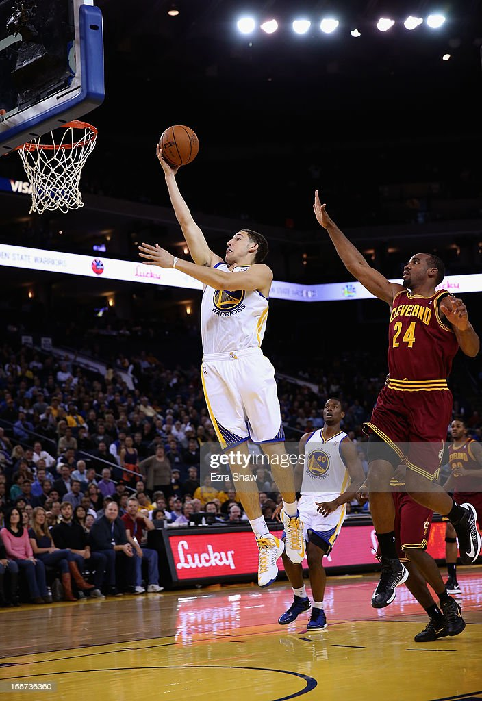Klay Thompson #11 of the Golden State Warriors drives past Samardo Samuels #24 of the Cleveland Cavaliers at Oracle Arena on November 7, 2012 in Oakland, California.