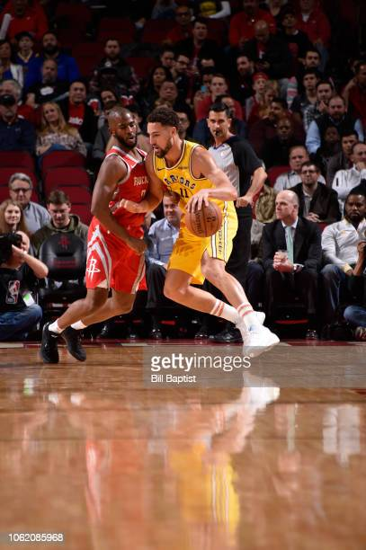Klay Thompson of the Golden State Warriors drives the ball against Chris Paul of the Houston Rockets on November 15 2018 at the Toyota Center in...