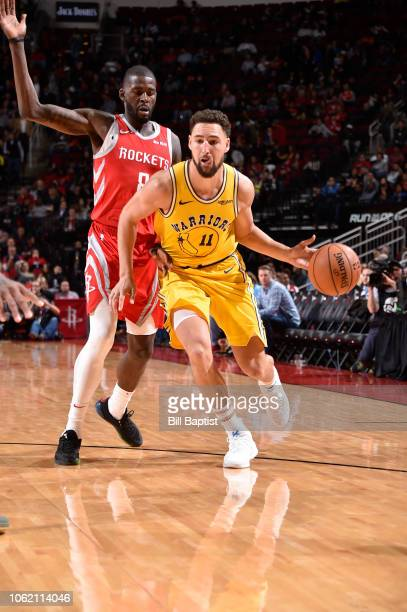Klay Thompson of the Golden State Warriors drives the ball against the Houston Rockets on November 15 2018 at the Toyota Center in Houston Texas NOTE...