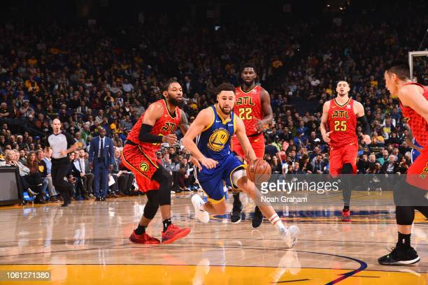 Klay Thompson of the Golden State Warriors drives to the basket against the Atlanta Hawks on November 13 2018 at ORACLE Arena in Oakland California...