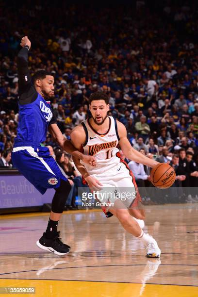 Klay Thompson of the Golden State Warriors drives to the basket against the LA Clippers on April 7 2019 at ORACLE Arena in Oakland California NOTE TO...
