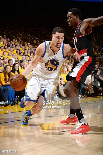 Klay Thompson of the Golden State Warriors drives to the basket during the game against AlFarouq Aminu of the Portland Trail Blazers in Game Two of...
