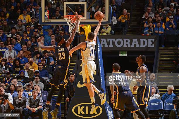 Klay Thompson of the Golden State Warriors drives to the basket against the Indiana Pacers on December 5 2016 at ORACLE Arena in Oakland California...