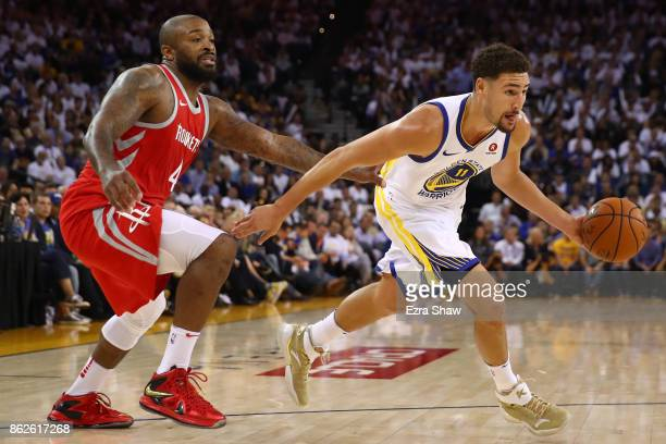 Klay Thompson of the Golden State Warriors drives to the hoop against PJ Tucker of the Houston Rockets during their NBA game at ORACLE Arena on...