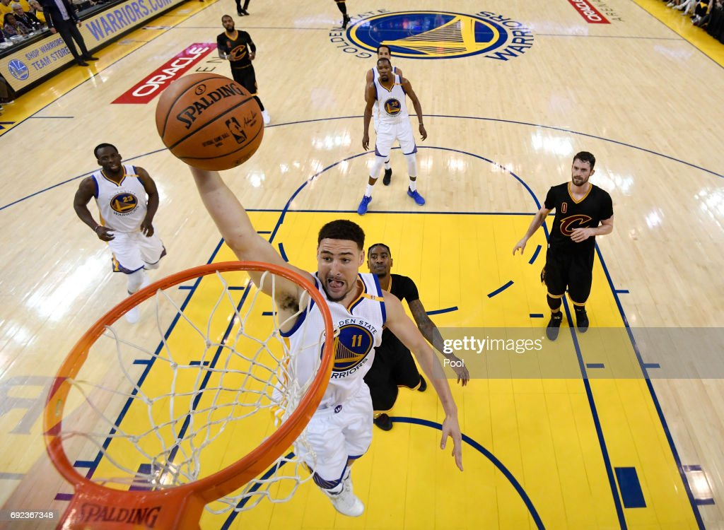 Klay Thompson #11 of the Golden State Warriors dunks the ball against the Cleveland Cavaliers in Game 2 of the 2017 NBA Finals at ORACLE Arena on June 4, 2017 in Oakland, California.