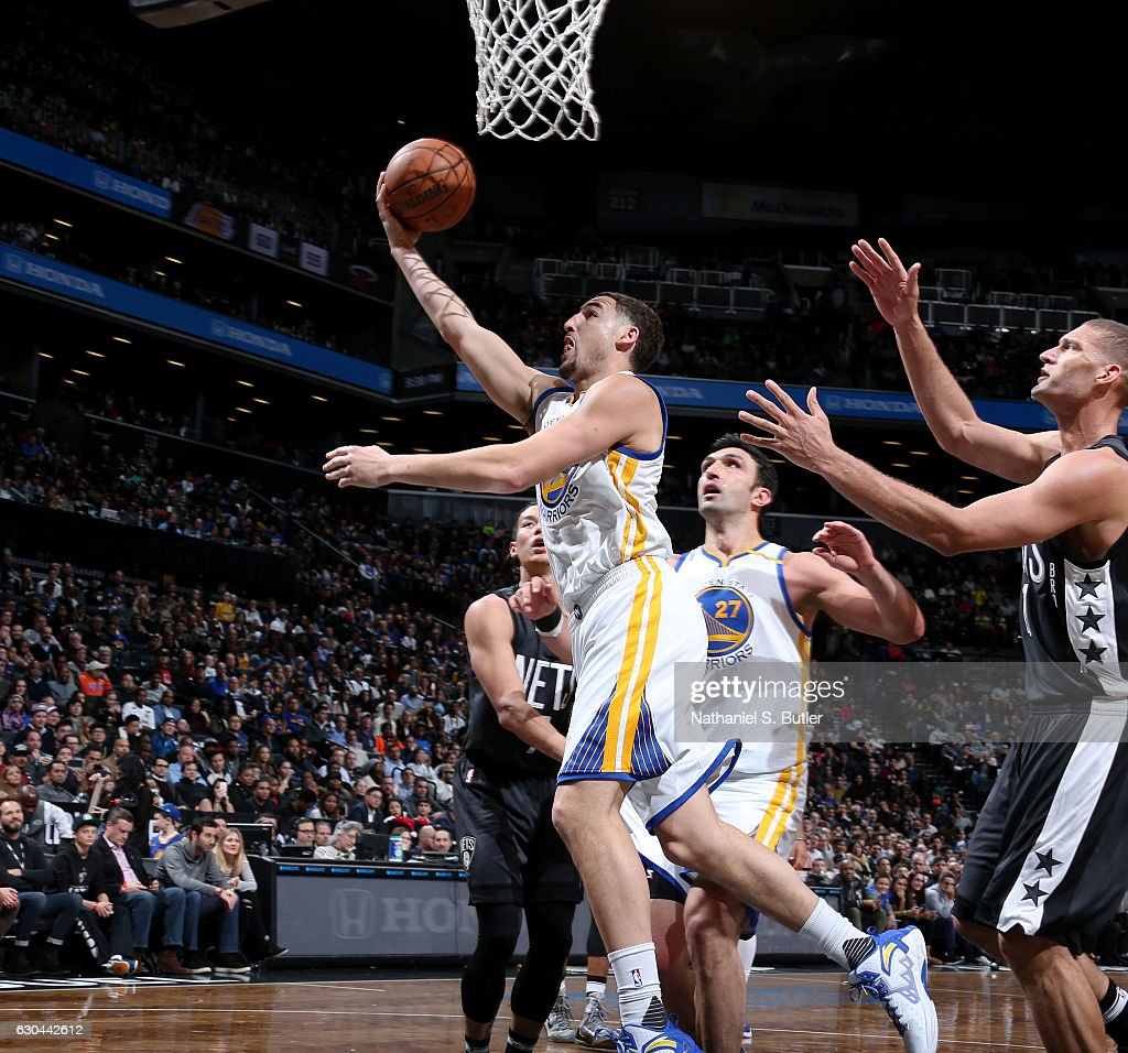 Klay Thompson #11 of the Golden State Warriors goes for a lay up against the Brooklyn Nets on December 22, 2016 at Barclays Center in Brooklyn, NY.