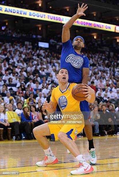 Klay Thompson of the Golden State Warriors goes in for a layup and gets fouled by Jared Dudley of the Los Angeles Clippers during the third quarter...