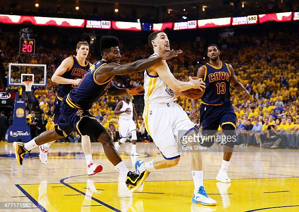 Klay Thompson of the Golden State Warriors goes up against Iman Shumpert of the Cleveland Cavaliers in the first quarter during Game Five of the 2015...
